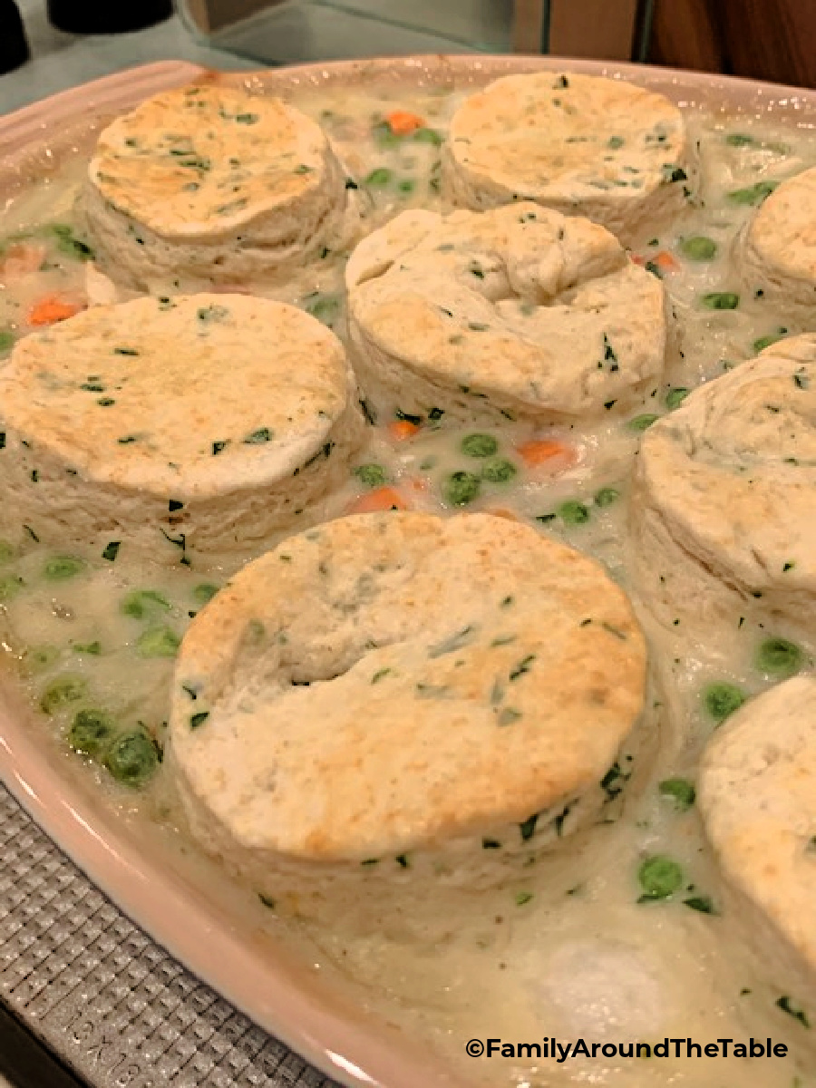 Chicken and biscuits in a baking dish.