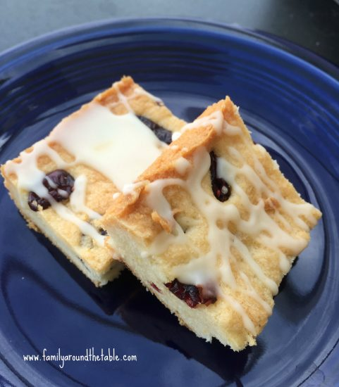 Cranberry Orange Shortbread Bars with Orange Glaze is a nice addition to a dessert table.