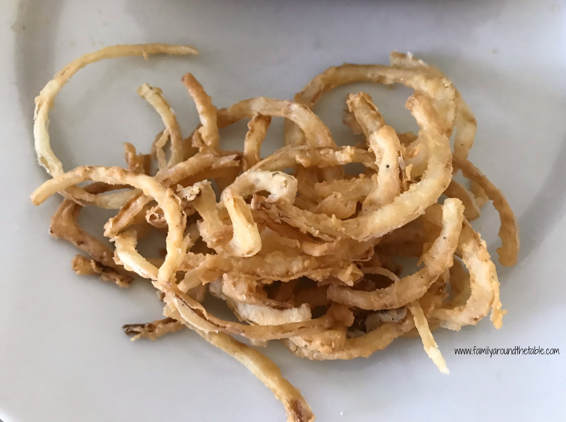 Fried onion straws just like you find in restaurants.