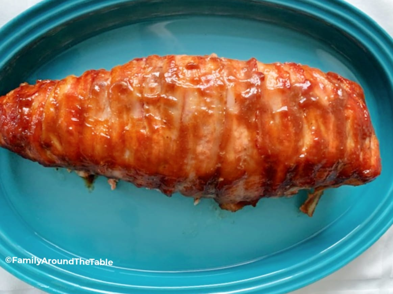 Honey BBQ Pork Tenderloin on a blue platter.