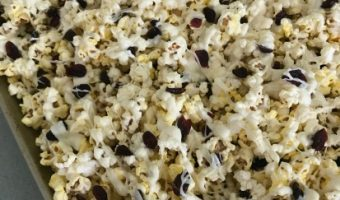 White chocolate cranberry popcorn makes a great holiday hostess gift.