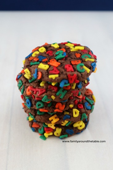Chocolate Sprinkle Cookies with ABC quins stacked on a counter.